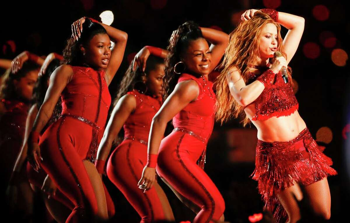 """(Right) Shakira's halftime performance at Hard Rock Stadium included her signature song, """"Hips Don't Lie."""""""