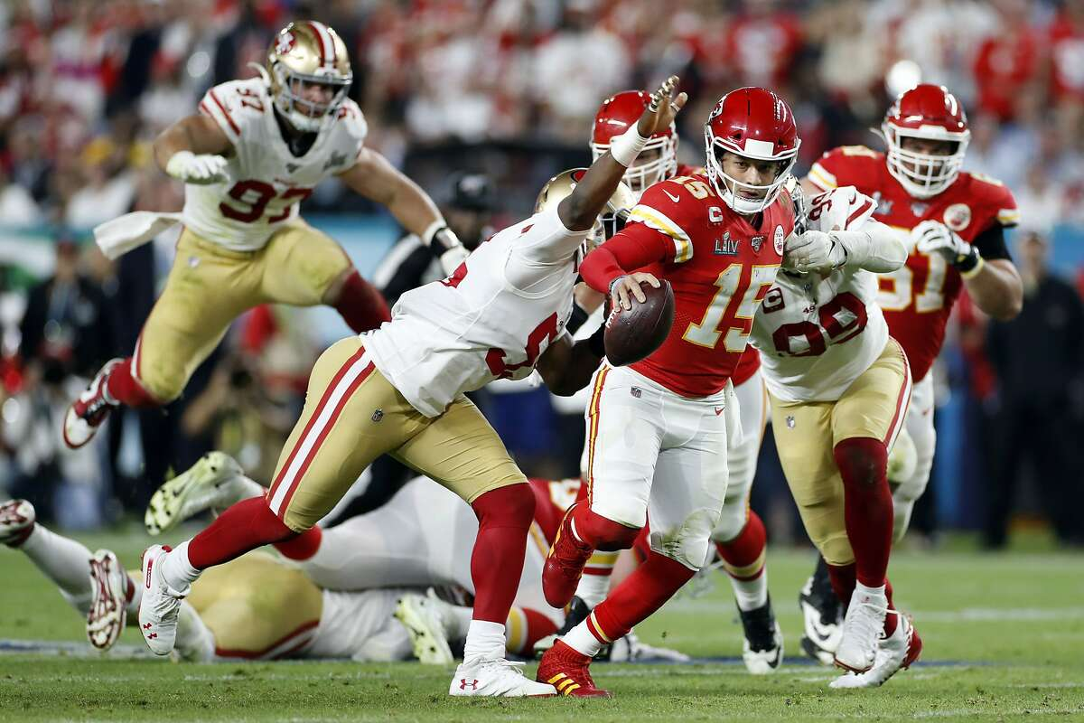 Kansas City Chiefs' Patrick Mahomes scrambles away from the San Francisco 49ers' defense in 4th quarter during Super Bowl LIV at Hard Rock Stadium in Miami Gardens, Florida, on Sunday, February 2, 2020.