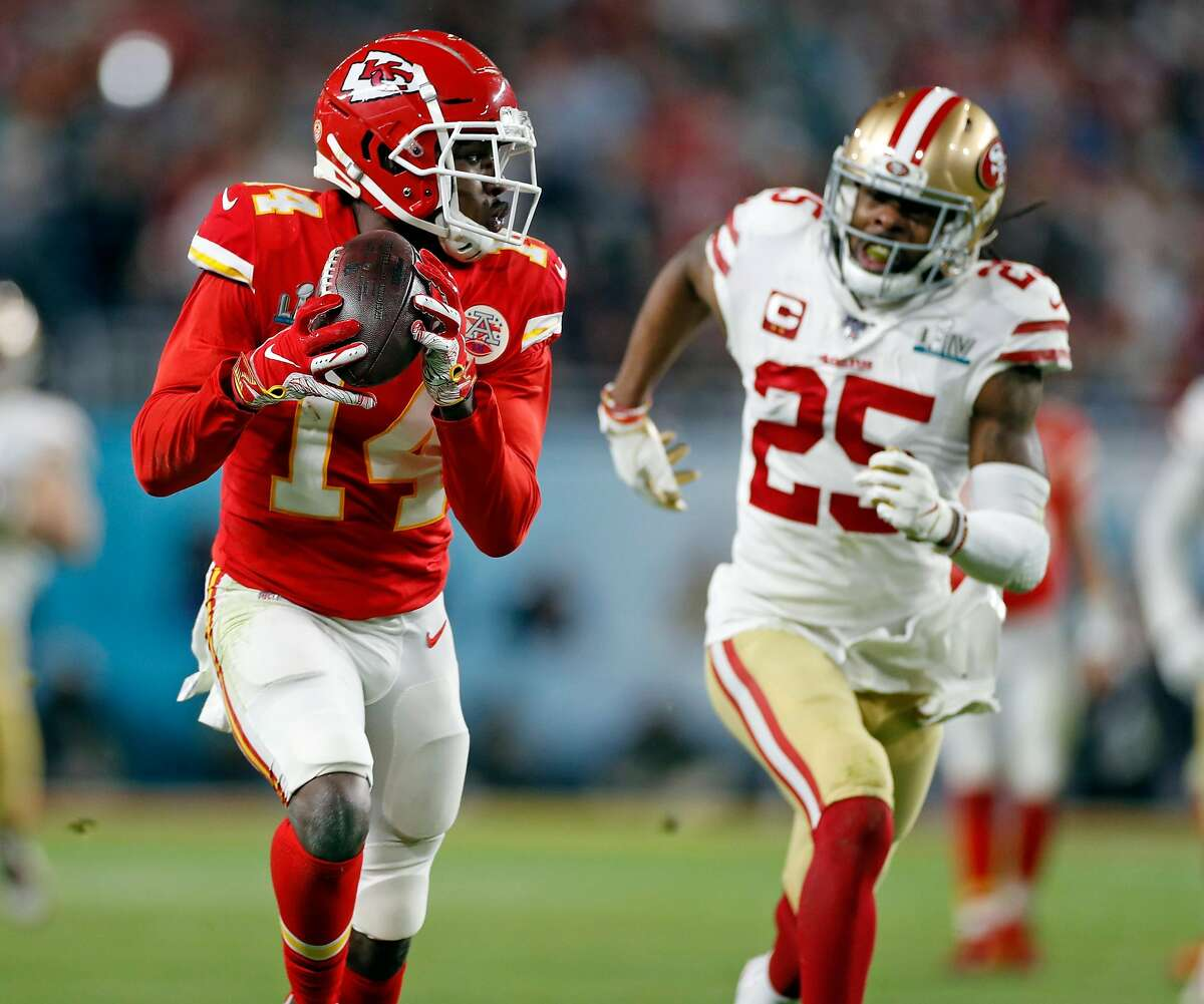 Kansas City Chiefs' Sammy Watkins catches a long pass in front of San Francisco 49ers' Richard Sherman in 4th quarter of Chiefs' 31-20 win during Super Bowl LIV at Hard Rock Stadium in Miami Gardens, Florida, on Sunday, February 2, 2020.