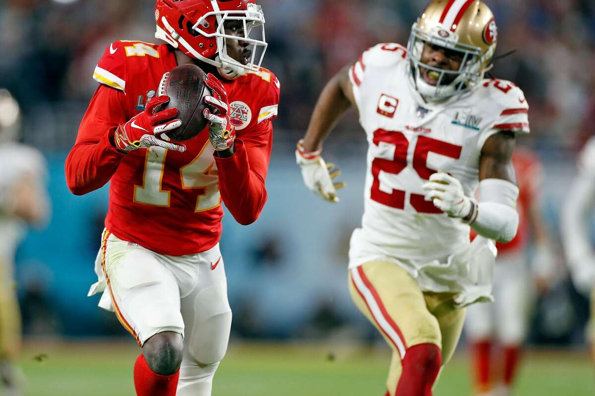 Kansas City Chiefs receiver Sammy Watkins catches a long pass in front of San Francisco 49ers' cornerback Richard Sherman in the fourth quarter of the Chiefs' 31-20 win in Super Bowl LIV.