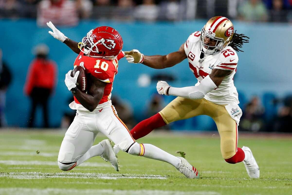 San Francisco 49ers' Richard Sherman tries to pull down Kansas City Chiefs' Tyreek Hill during Super Bowl LIV at Hard Rock Stadium in Miami Gardens, Florida, on Sunday, February 2, 2020.