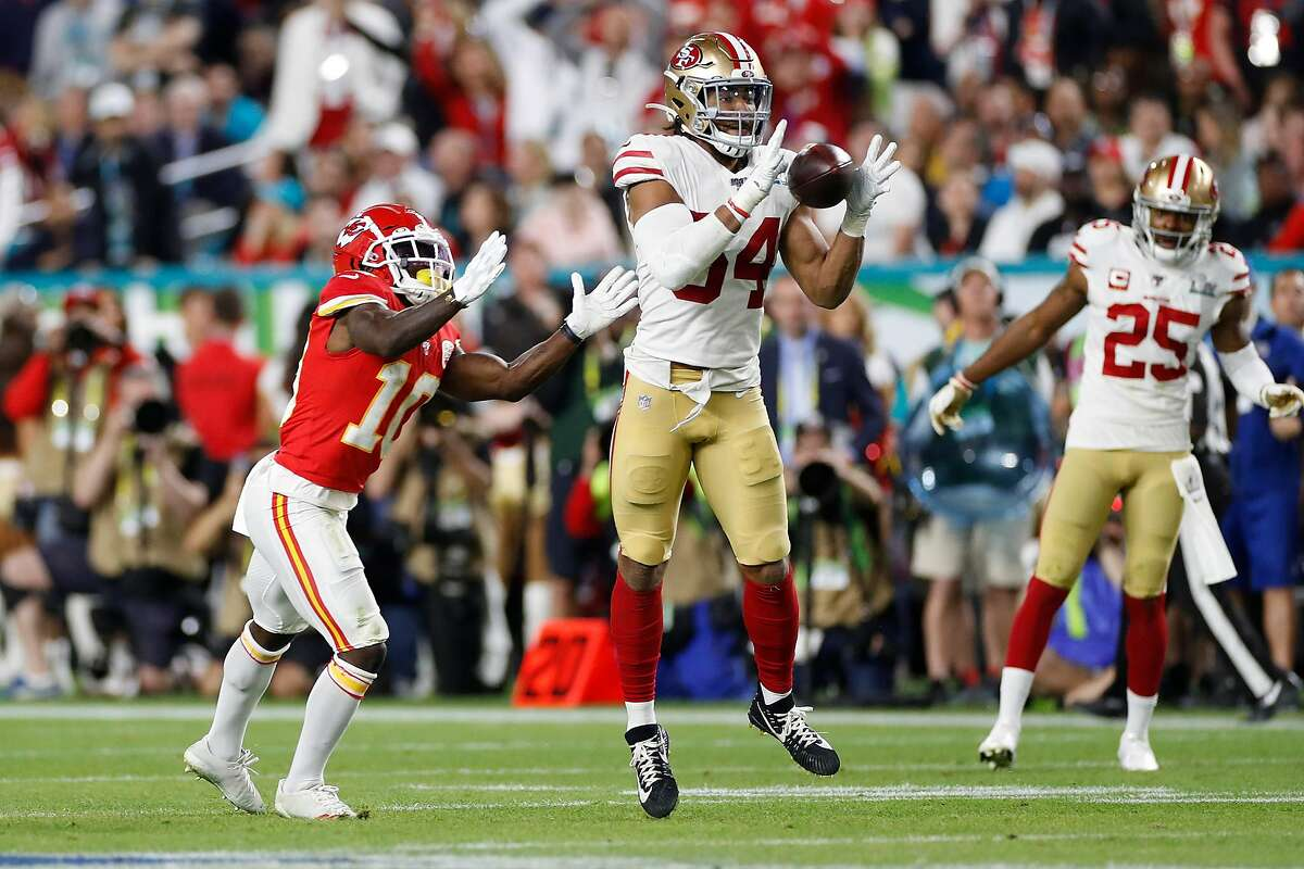 San Francisco 49ers' Fred Warner intercepts a pass in front of Kansas City Chiefs' Tyreek Hill during Super Bowl LIV at Hard Rock Stadium in Miami Gardens, Florida, on Sunday, February 2, 2020.
