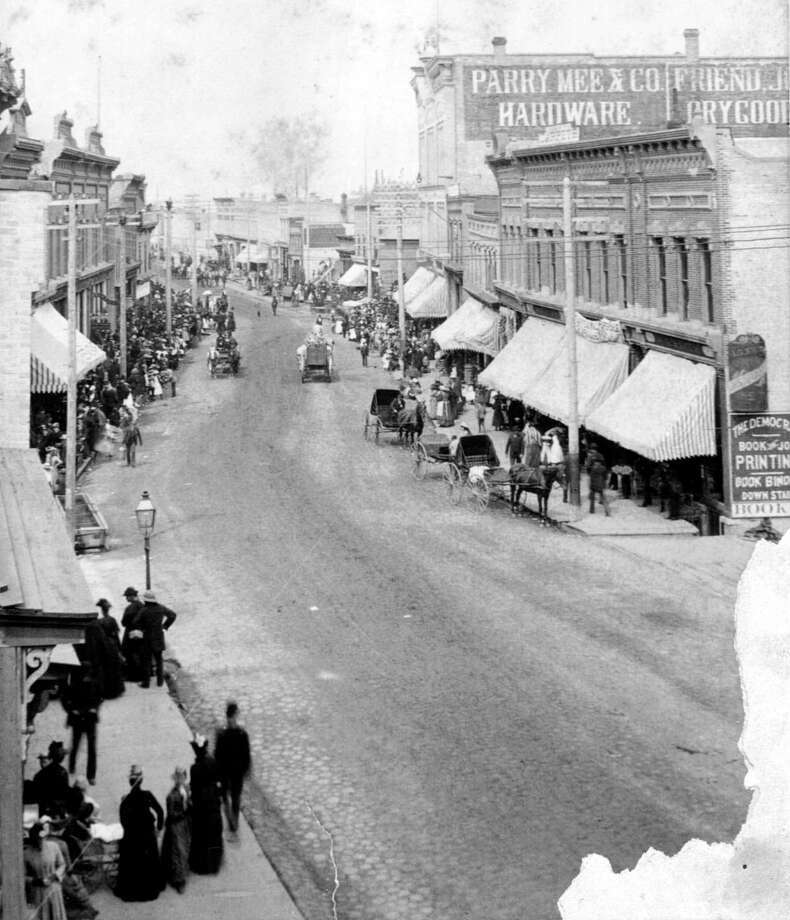 The Manistee River Street area slightly resembles the street that exists today in this 1890s photograph.