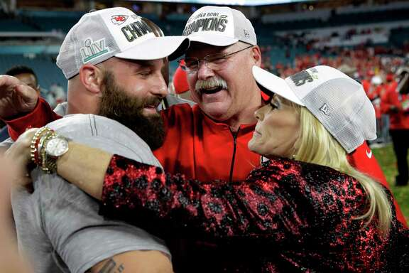 Kansas City Chiefs head coach Andy Reid, center, celebrates with wife Tammy, right, and Travis Kelce after the NFL Super Bowl 54 football game against the San Francisco 49ers, Sunday, Feb. 2, 2020, in Miami Gardens, Fla. The Kansas City Chiefs won 31-20.