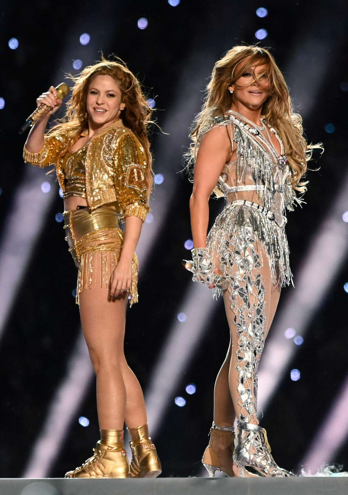 MIAMI, FLORIDA - FEBRUARY 02: (L-R) Shakira and Jennifer Lopez perform onstage during the Pepsi Super Bowl LIV Halftime Show at Hard Rock Stadium on February 02, 2020 in Miami, Florida. (Photo by Kevin Mazur/WireImage)