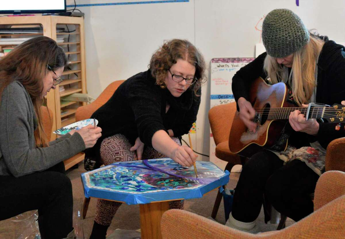 Kimberly Megoran (right), who founded the art and music collaborative called Love Street Live, participates in the Children's Grief Center facilitator training on Saturday, Feb. 1, 2020. She had other LSL members join her so that they can use art and music to help grieving children heal. (Ashley Schafer/Ashley.Schafer@hearstnp.com)