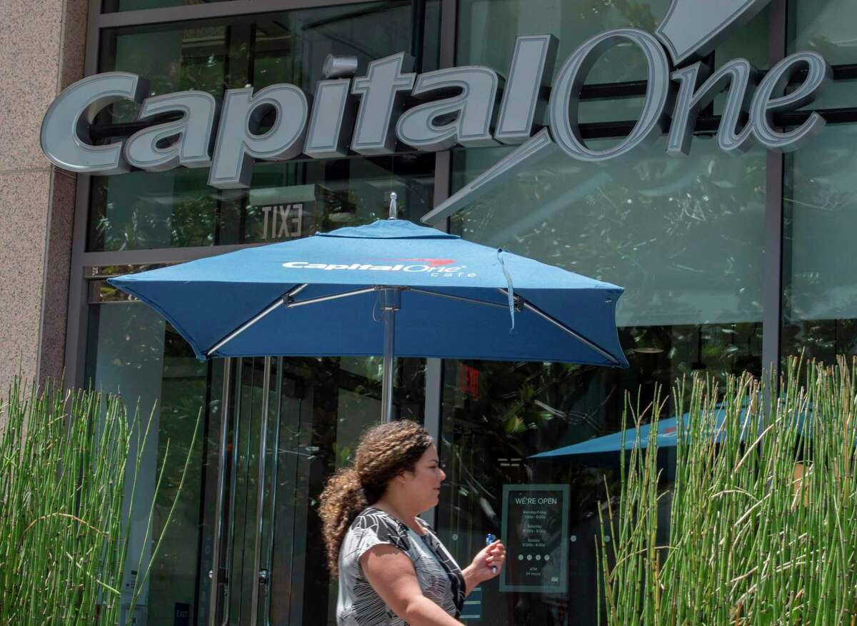 People walk past a Capital One Bank branch in Los Angeles, California on July 31, 2019. - A hacker accessed more than 100 million credit card applications with US financial heavyweight Capital One, the firm said on July 29, 2019, in one of the biggest data thefts to hit a financial services company. FBI agents arrested Paige Thompson, 33, a former Seattle technology company software engineer, after she boasted about the data theft on the information sharing site GitHub, authorities said. (Photo by Mark RALSTON / AFP)MARK RALSTON/AFP/Getty Images