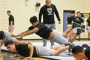 This Jan. 27, 2020 file photo shows United South football players training under the guidance of head coach Joe Coss. UISD announced Thursday it is suspending strength and conditioning programs indefinitely.