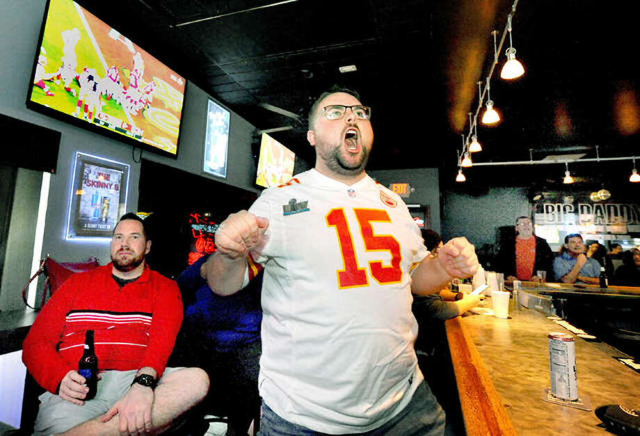 Doug Croft, of Edwardsville, cheers while watching the Super Bowl at Big Daddy's sports bar in Edwardsville as the Kansas City Chiefs make it to the one-yard line in the first half Sunday. The Chiefs went on to score a touchdown and beat out the San Francisco 49ers for the title, 31-20. The win is the first for the Chiefs in 50 years. Photo: Thonas Turney|For The Intelligencer