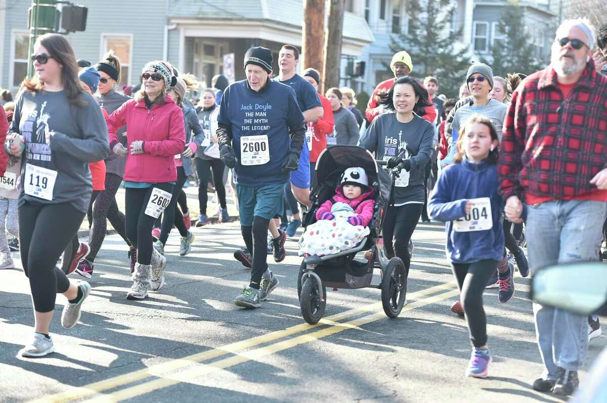 New Haven, Connecticut - February 02, 2020: Run for the Refugees 5K road race and walk Sunday morning in New Haven that benefits IRIS (Integrated Refugee and Immigrant Services), starting and ending at Wilbur Cross High School.