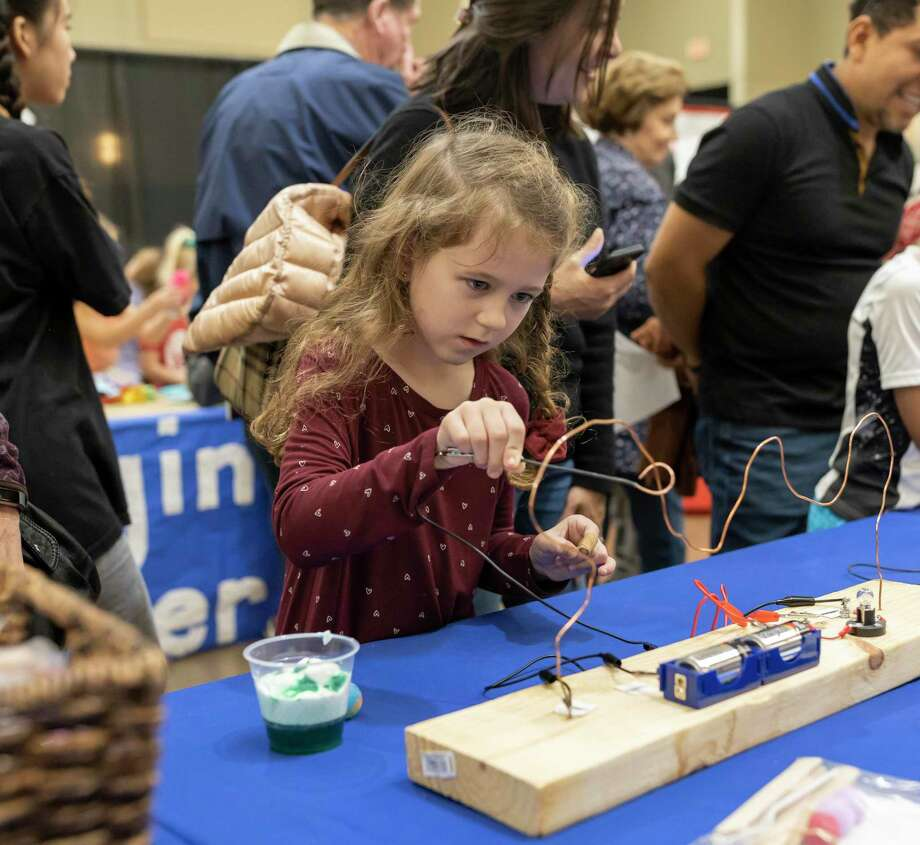 "Sophie Schnitger, 7, experiments with the circuits provided by San Jacinto Elementary at the Lone Star Convention Center in Conroe, Saturday, Feb. 1 , 2020. This is the 30th annual Sci://Tech Expo Day and this year's theme was ""Science: It's Worth Exploring,"" Photo: Gustavo Huerta, Houston Chronicle / Staff Photographer / Houston Chronicle"