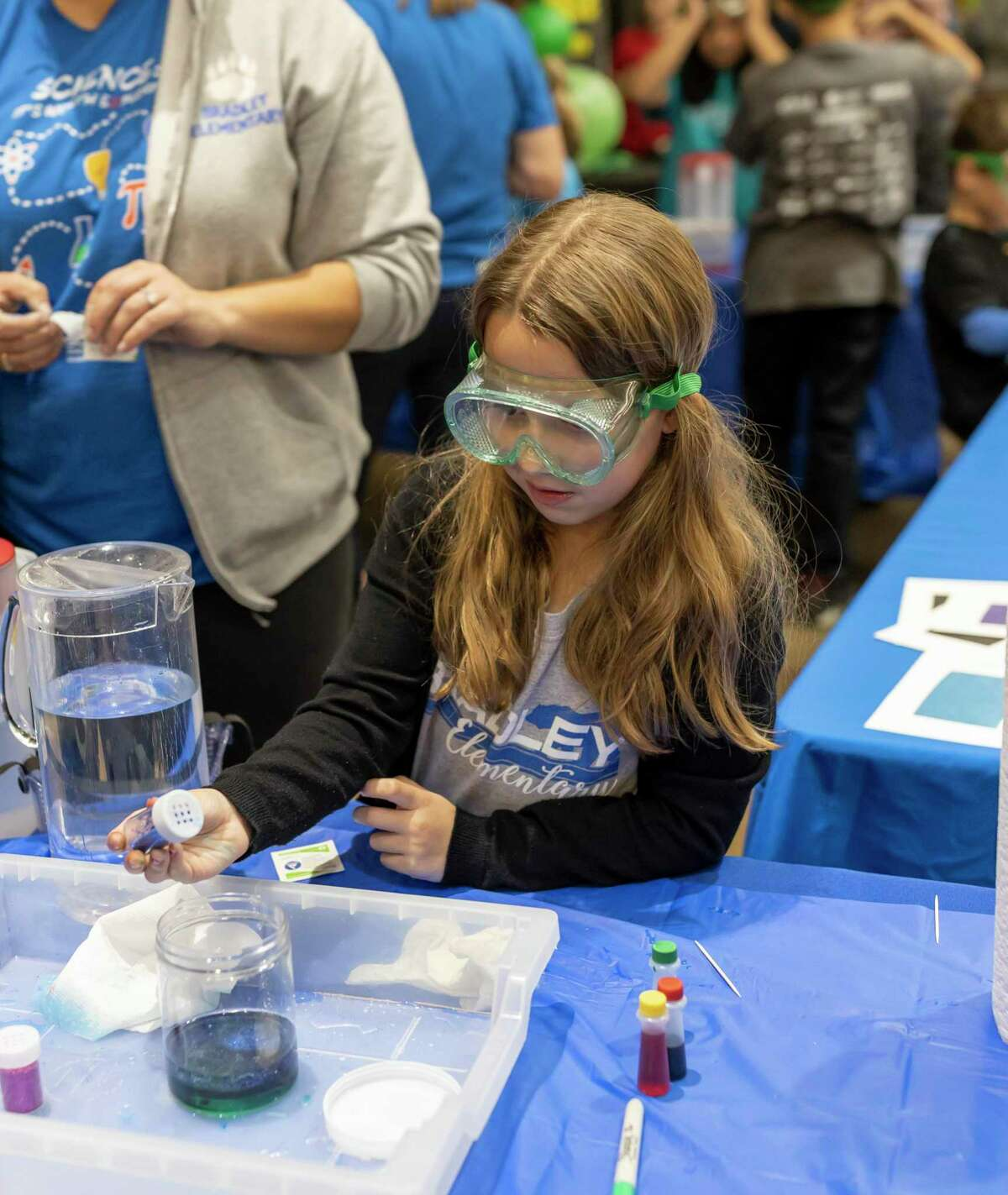 """Harlow Champion, student from Bradley Elementary, demonstrates what happens when mixing baby oil, food coloring and water at the Lone Star Convention Center in Conroe, Saturday, Feb. 1 , 2020. This is the 30th annual Sci://Tech Expo Day and this year's theme was """"Science: It's Worth Exploring,"""""""