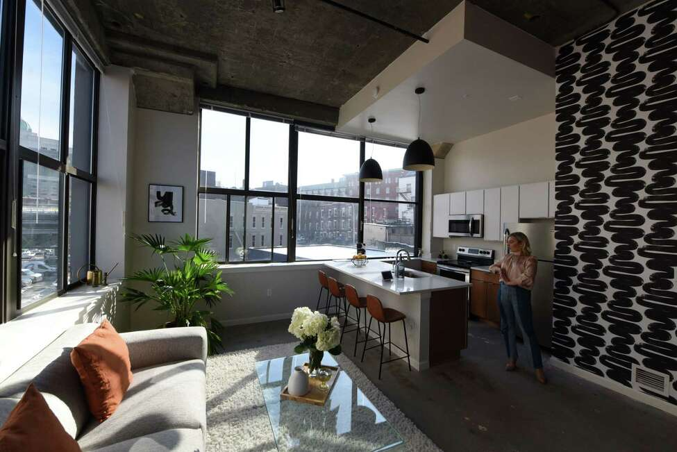 Living and dining space inside Taylor Rao's new apartment at The Knick on Friday, Jan. 24, 2020, in Albany, N.Y. Rao decorated her downtown dwelling. (Will Waldron/Times Union)