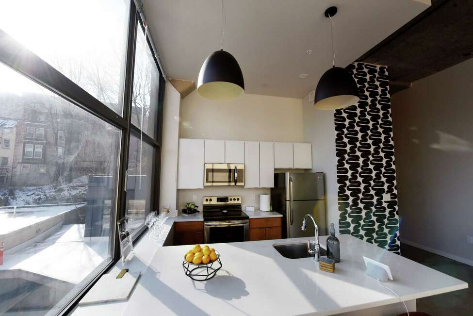 Kitchen and dining space inside Taylor Rao's new apartment at The Knick on Friday, Jan. 24, 2020, in Albany, N.Y. Rao decorated her downtown dwelling. (Will Waldron/Times Union)