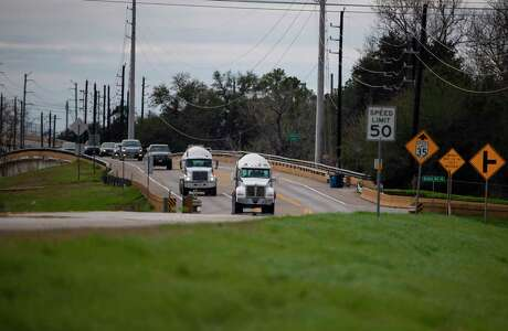 Traffic moves along FM 723 north of the Brazos River on Jan. 29, 2020, in Rosenberg. The Texas Department of Transportation is working on plans to elevate FM 723 north of the river an additional five feet as part of a widening project.