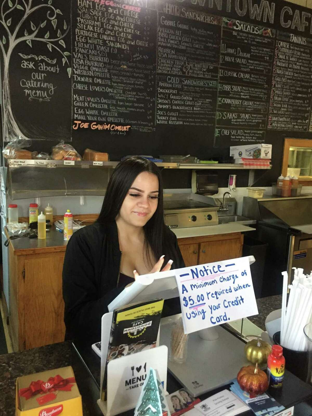 Mariah, a Work to Learn client, works the register at her internship through the program.