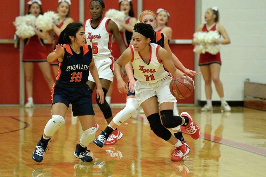 Allana Thompson (11) of Katy dribbles around Ximena Diez (10) of Seven Lakes during the second half of a 6A Region III District 19 Girls basketball game between the Katy Tigers and the Seven Lakes Spartans on Friday, January 31, 2020 at Katy HS, Katy, TX. Photo: Craig Moseley, Houston Chronicle / Staff Photographer / ©2020 Houston Chronicle
