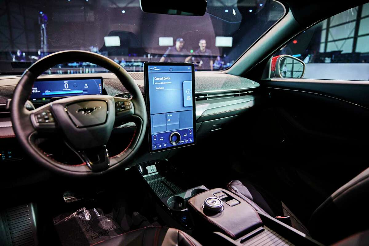 The interior of the electric Ford Mustang Mach E. Despite slumping global sales and fading government subsidies, auto manufacturers are only increasing their commitment to a technology that for now occupies a small fraction of a world market dominated by gasoline and diesel-powered vehicles.