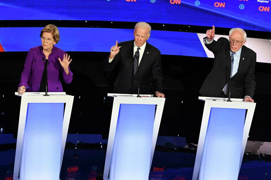 (FILES) In this file photo taken on January 14, 2020 Democratic presidential hopefuls Massachusetts Senator Elizabeth Warren (L), former Vice President Joe Biden (C) and Vermont Senator Bernie Sanders participate in the seventh Democratic primary debate of the 2020 presidential campaign season co-hosted by CNN and the Des Moines Register at the Drake University campus in Des Moines, Iowa. - The US presidential race begins in earnest on February 3, 2020 when Iowans take the first votes in the process that ultimately determines which Democrat will face incumbent Donald Trump in November. (Photo by Robyn Beck / AFP) (Photo by ROBYN BECK/AFP via Getty Images) Photo: ROBYN BECK, Contributor / AFP Via Getty Images / AFP or licensors