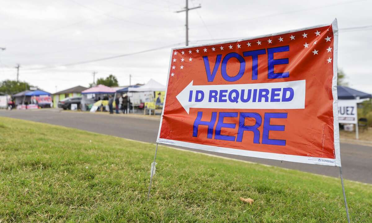 Supporters of local candidates setup outside the Sophie Christen McKendrick Francisco Ochoa Fernando A. Salinas Branch Library on Dec. 3, 2018, as early voting begins for run-off elections.