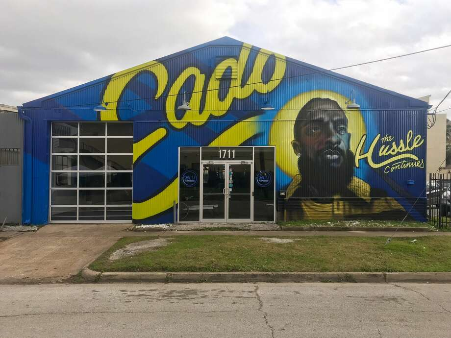A new mural honoring the late rapper Nipsey Hussle has taken over the front facade of a fitness gym in east downtown Houston. Photo: Anthony Rose/Michael Arguello