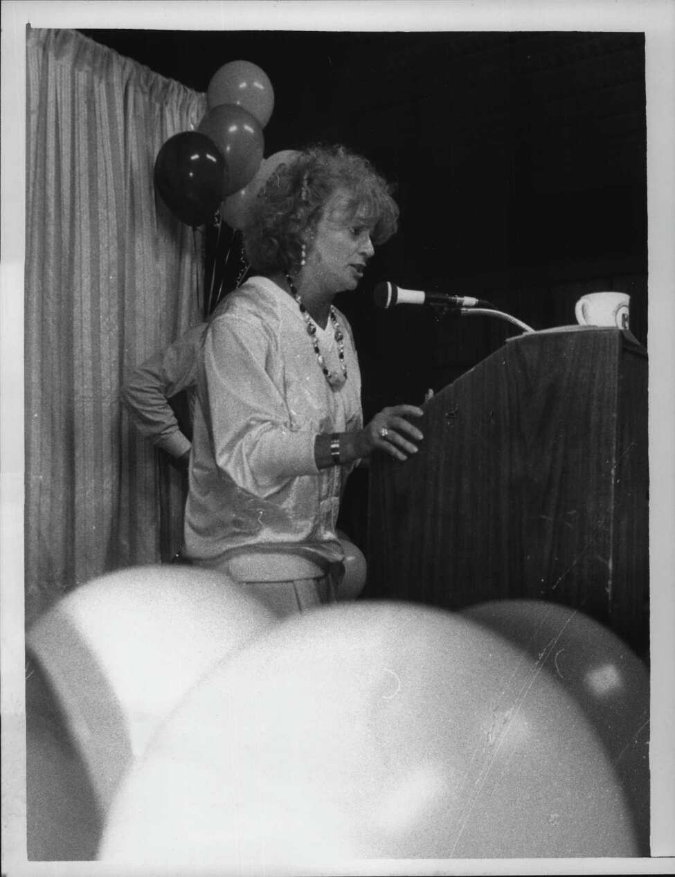 Mimi Scott at the Turf Inn, sings show tunes for $100 donation. April 9, 1986 (Paul D. Kniskern Sr./Times Union Archive)