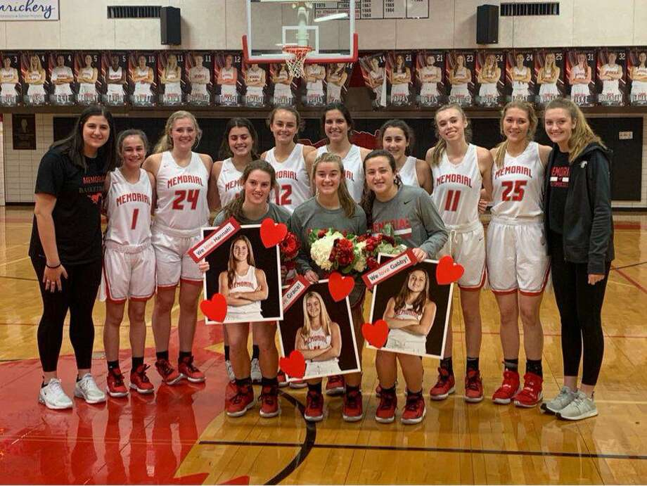 The Memorial girls basketball team defeated Northbrook in District 17-6A play and honored seniors (front, from left) Hannah Schweitzer, Grace Wilson and Gabby Garofalo, Jan. 31 at Memorial High School. Photo: Memorial High School / Memorial High School