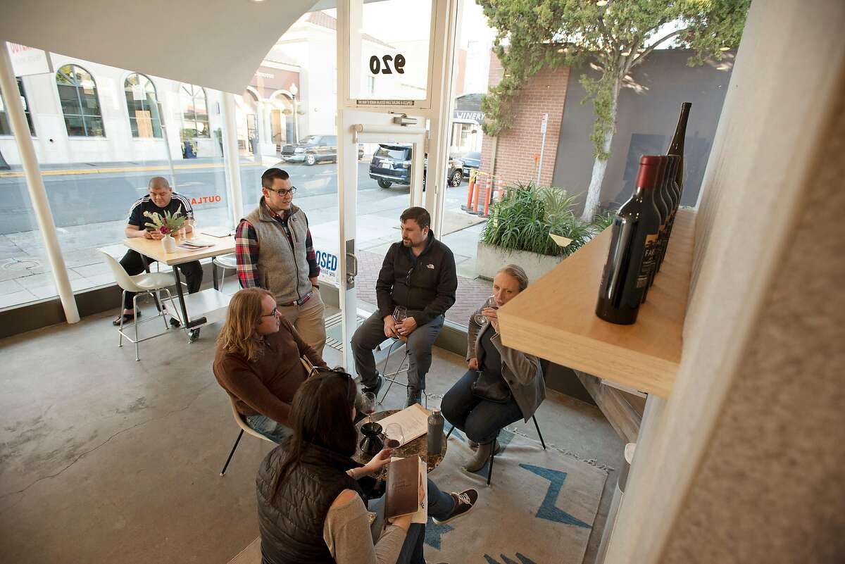 General Manager Alex Leonardini, left, chatting with a group of students in the Institute of Masters of Wine program at Outland tasting room, which offers California wines produced by POE, Forlorn Hope and Farella, located in downtown Napa, Calif. on February 2, 2020.