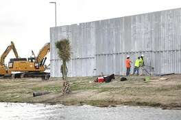 Construction of a border wall by the Fisher Sand and Gravel Co. is seen along the Rio Grande south of Mission, Texas.