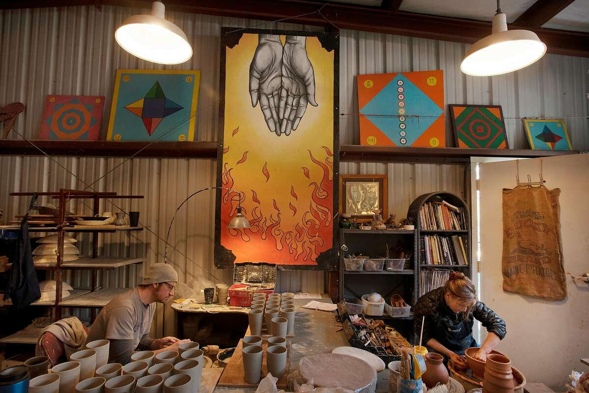 Will Callnan, left, and Nikki Ballere Callnan have workstations within arm's reach of each other at their home business NBC Pottery Napa Valley in Angwin, Calif. on January 30, 2020.