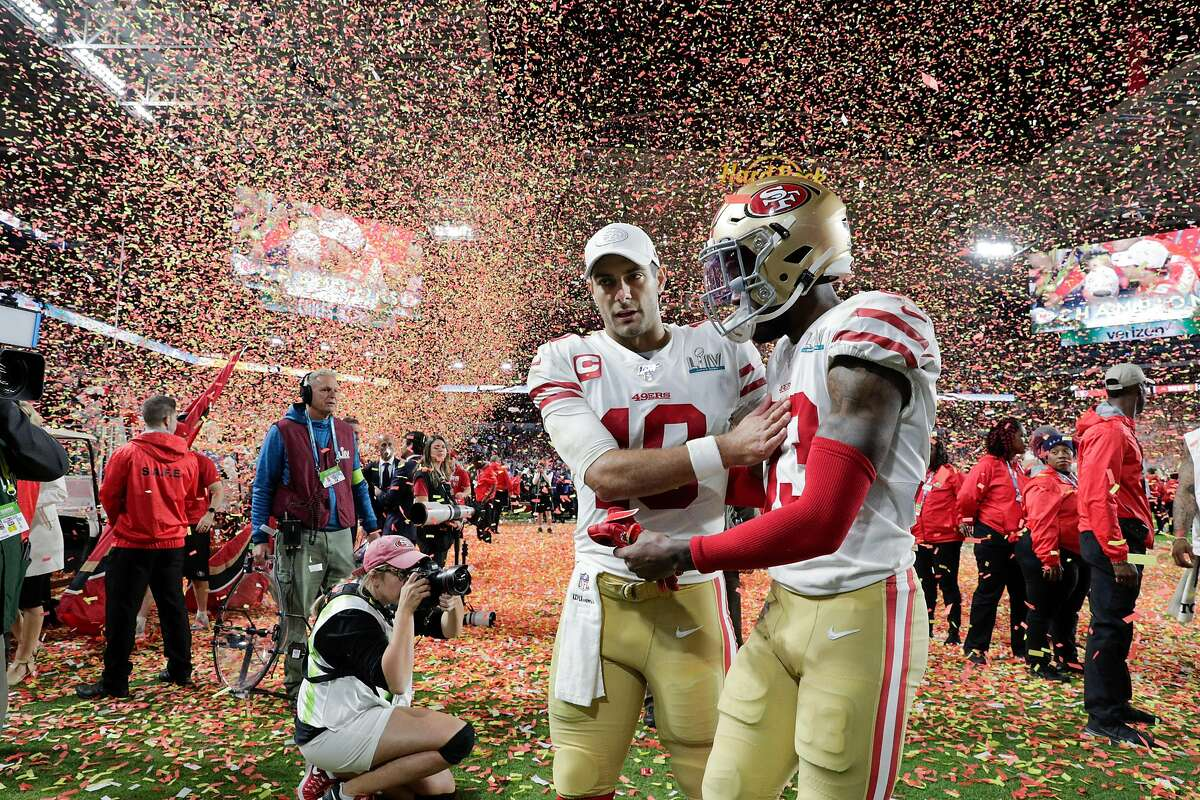 San Francisco 49ers' Jimmy Garoppolo and Levine Toilolo walk off the field after the 49ers were defeated 31 to 20 in Super Bowl LIV between the San Francisco 49ers and the Kansas City Chiefs at Hard Rock Stadium on Sunday, Feb. 2, 2020 in Miami Gardens, Fla.