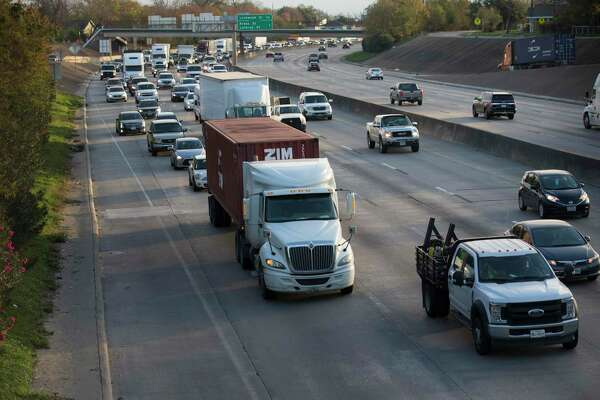 Traffic begins to flow again on Interstate 10 after Houston Police Department reopened the freeway at Waco Street on Dec. 17, 2019, in Houston. A rig struck the Waco Street bridge and the highway was temporarily shut down.