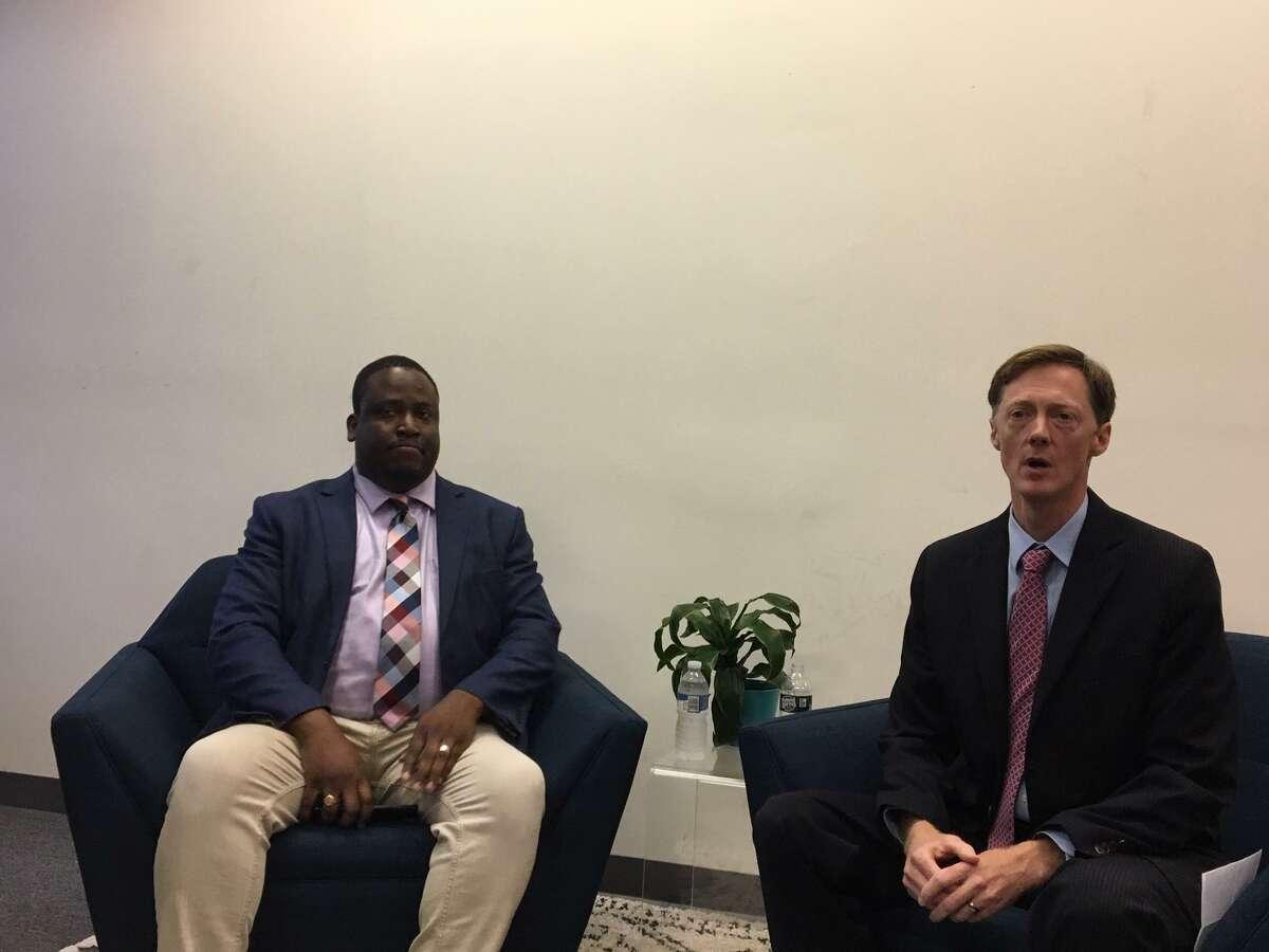 Alder Darryl Brackeen Jr., left, and then-mayoral candidate Justin Elicker.