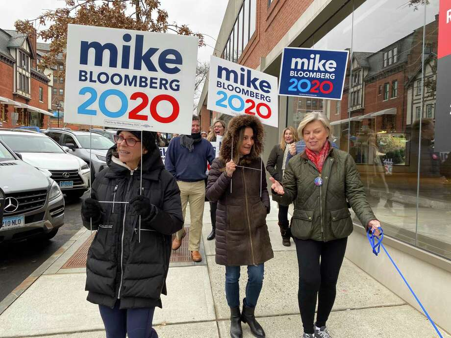 Volunteers with the Mike Bloomberg for president campaign canvass in downtown Greenwich, holding lawn signs and signing up residents to get involved with the campaign Photo: Contributed