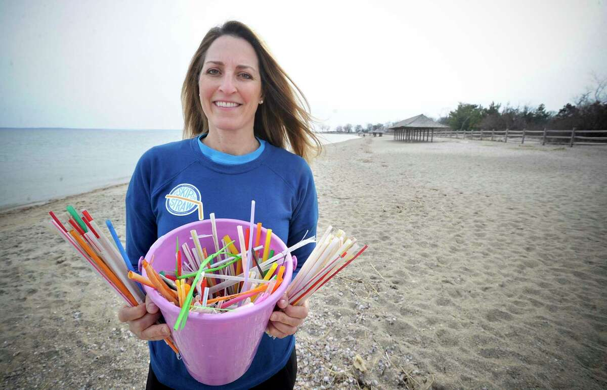 Julie DesChamps, founder of Waste Free Greenwich, seen here gathering straws off of Greenwich Point, said that she expects the food scrap recycling program to be a success once it can start.