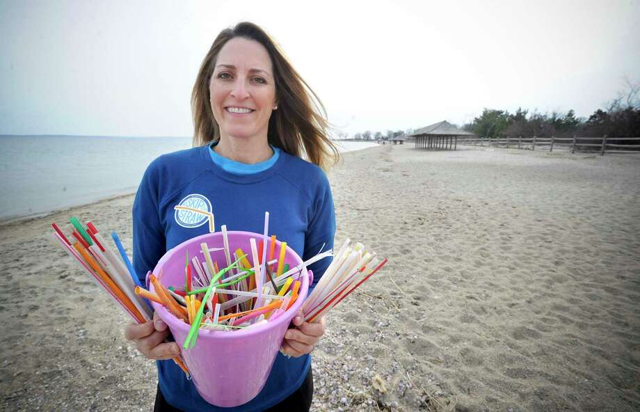 Julie DesChamps, founder of Waste Free Greenwich, seen here gathering straws off of Greenwich Point, said that she expects the food scrap recycling program to be a success once it can start. Photo: Matthew Brown / Hearst Connecticut Media / Stamford Advocate