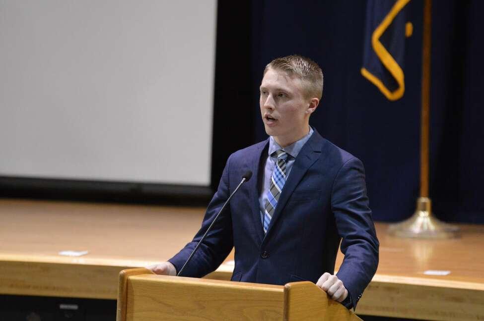 Kason Romanowski, a Columbia High School senior, moderates legislative panel on state aid formula on Jan. 30, 2020.
