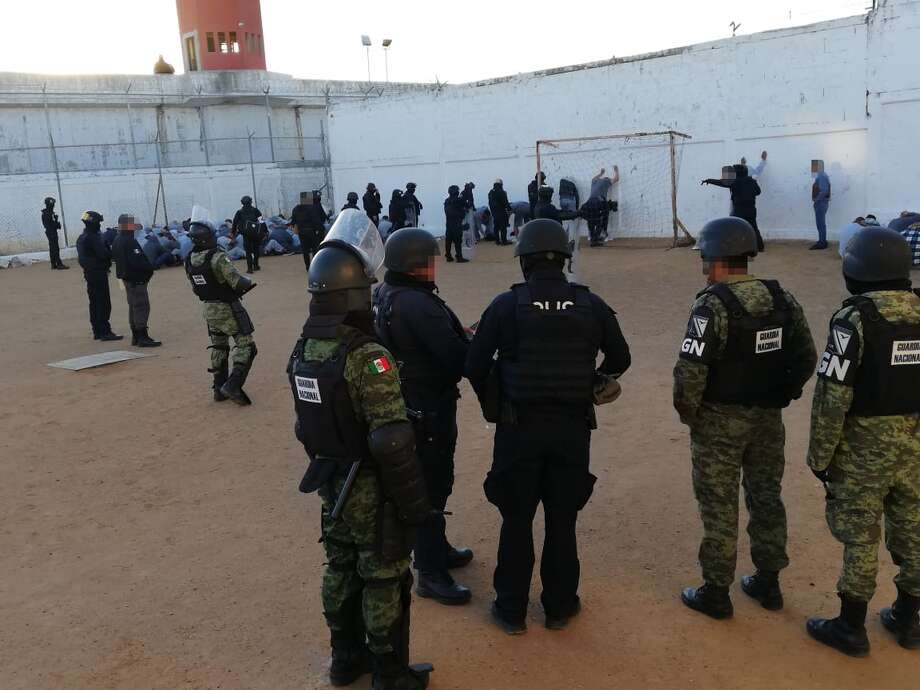 Mexican National Guard soldiers and Tamaulipas state police officers patted down inmates during an operation on Wednesday at the prison in Nuevo Laredo. Photo: Courtesy Photo/Tamaulipas Government