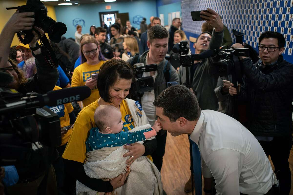 Pete Buttigieg, the former mayor of South Bend, Ind., and a Democratic candidate for president, is greeted by campaign worker Tara Henson and her son, Emerson, 7 months, as he visits his campaign office in West Des Moines, Iowa, on Monday, Feb. 3, 2020. The Iowa presidential caucuses begin Monday night at more than 1,600 sites across the state. (Todd Heisler/The New York Times)