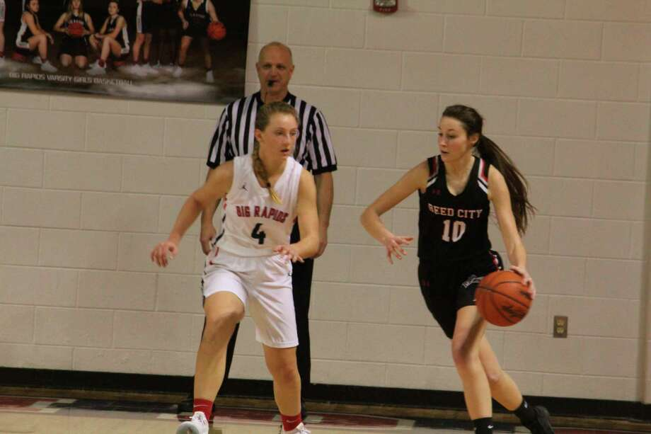 Reed City's Mackenzie Vandawater (10) looks to make a move on Big Rapids' Holly McKenna during recent action. (Pioneer photo/John Raffel)