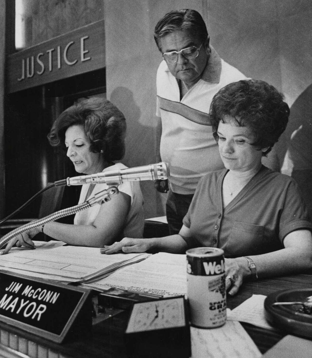 Mayor Jim McConn looks over City Secretary Anna Russell's shoulder on election night on Aug. 11, 1979, before the days of computerized election returns. The woman at left is assistant Becky Demeris.