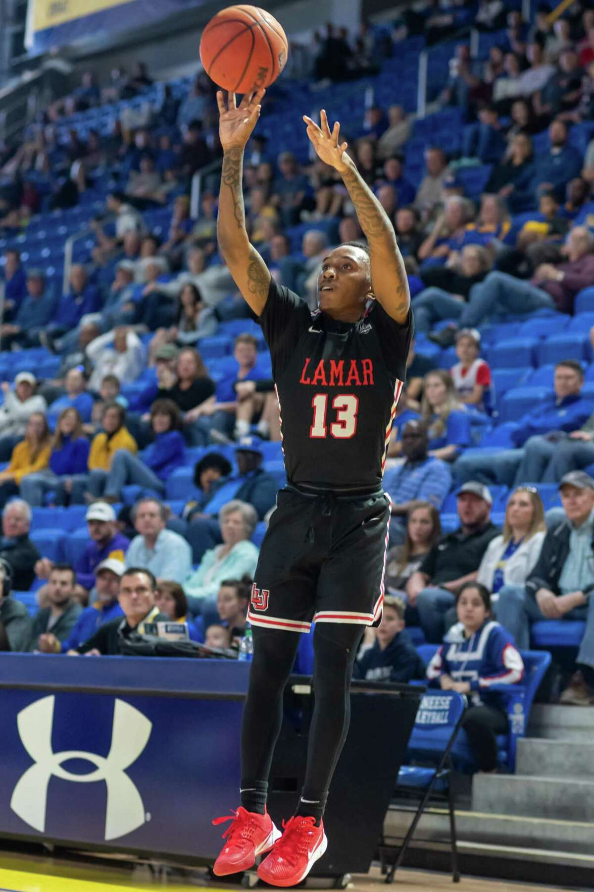 Davion Buster (13) puts up a three-pointer for three of his 39 points in the game as the Lamar Cardinals headed to Lake Charles to take on the McNeese Cowboys on February 1, 2020. Fran Ruchalski/The Enterprise