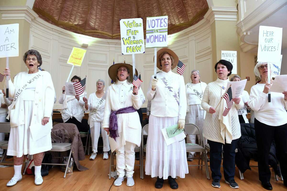 The Suffragette Choir led by Linda Whittaker (far left) sings a selection from the Suffrage Song Handbook during the Milford Suffrage Centennial Committee's kickoff event at City Hall in Milford on January 28, 2020 celebrating the 100th anniversary of the ratification of the 19th Amendment giving women the right to vote.