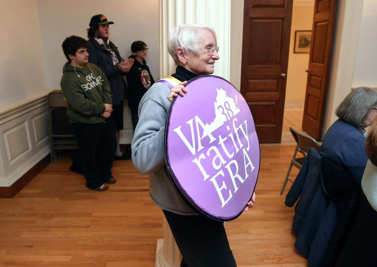 Maggie Goodwin of West Haven attends the Milford Suffrage Centennial Committee's kickoff event at City Hall in Milford on January 28, 2020 celebrating the 100th anniversary of the ratification of the 19th Amendment giving women the right to vote. Her sign is about the Equal Rights Amendment and it's ratification in Virginia.
