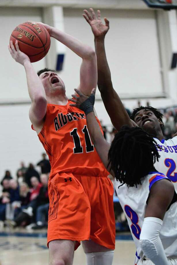 Ridgefield's Luke McGarrity scored 33 points in just three quarters in a win over New Canaan. Photo: Erik Trautmann / Hearst Connecticut Media / Norwalk Hour