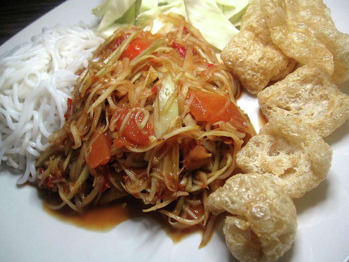Papaya salad comes with noodles and chicharrones at Thai Lucky Sushi Bar downtown.