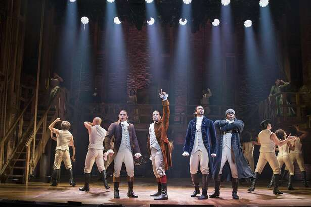 """FILE -- From left: Anthony Ramos, Lin-Manuel Miranda, Daveed Diggs and Okieriete Onaodowan in """"Hamilton"""" at the Richard Rodgers Theatre in New York, July 11, 2015. A filmed version of the stage performance - with the original Broadway cast - will be distributed to movie theaters late next year. (Sara Krulwich/The New York Times)"""