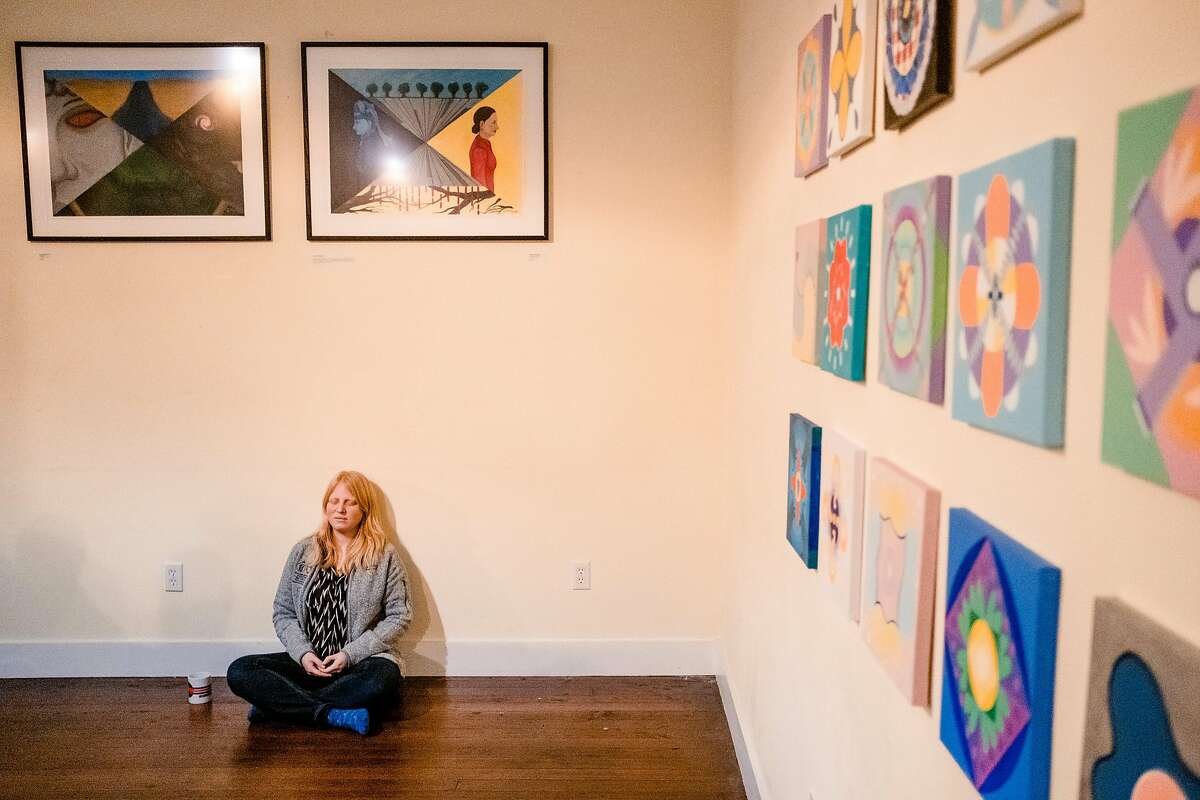 """Kati Devaney Co-founder and COO of the San Francisco Dharma Collective meditates at the beginning of an event held at the Collective called """"The Promises and Perils of Hacking Consciousness"""" in San Francisco, Calif. on Tuesday January 28, 2020."""