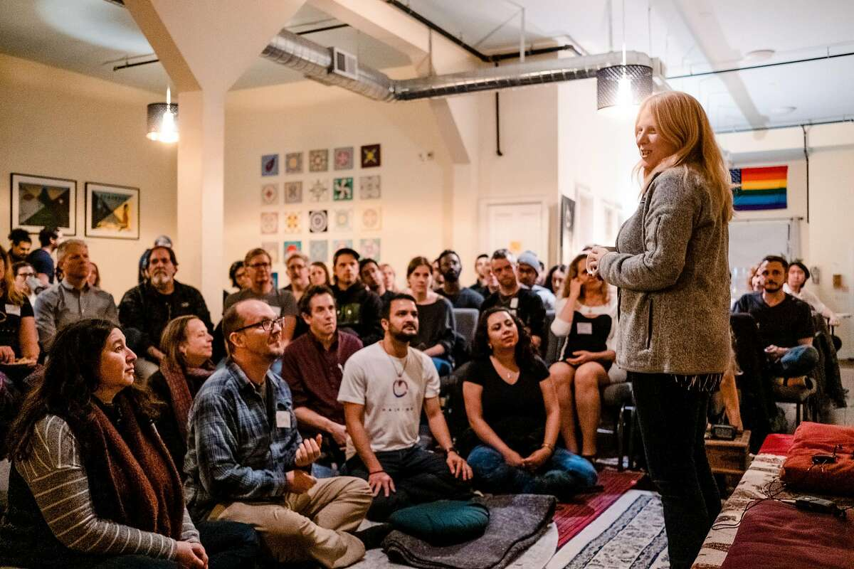 """Kati Devaney Co-founder and COO of the San Francisco Dharma Collective speaks to attendees during an event at the Collective called """"The Promises and Perils of Hacking Consciousness"""" in San Francisco, Calif. on Tuesday January 28, 2020."""