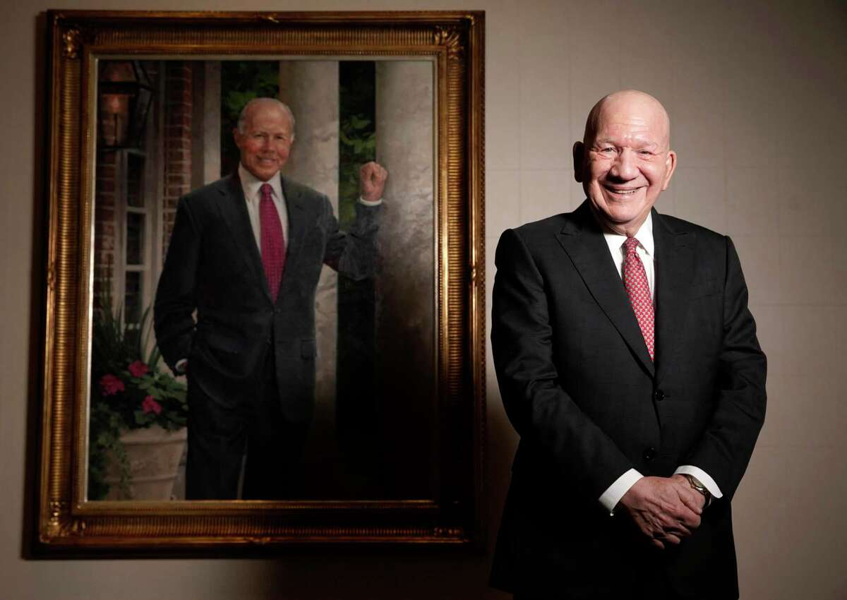 Enterprise Products Partners Co-CEO Jim Teague with a portrait of the late Dan Duncan, who founded with company in 1968 with a pair of propane delivery trucks. The company is looking at ways to trim its multi-billion dollar capital expenditure budget cuts as the ongoing oil war takes its toll on the company's customers.
